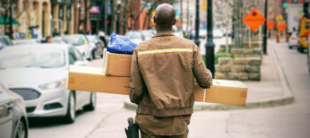 Delivery person carrying packages