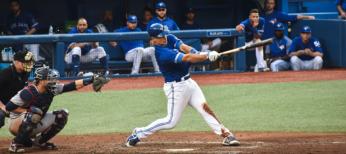 Baseball player swinging at pitch